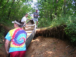 Pushing the canoe up the ditch