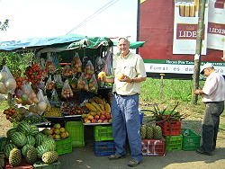 Wilson buying another mango in Costa Rica