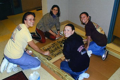 Earth Team making a sign